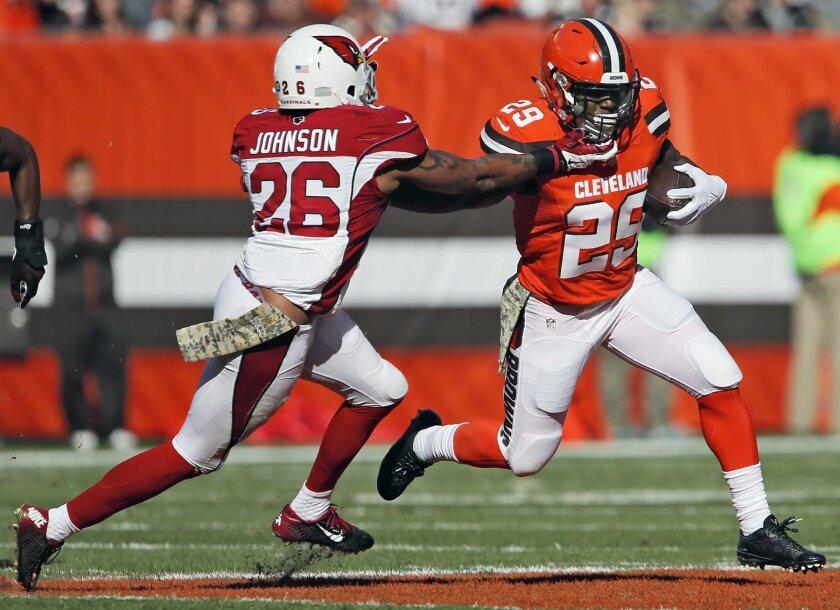 Cleveland Browns running back Duke Johnson Jr. gets past Arizona Cardinals safety Rashad Johnson during an NFL football game Sunday, Nov. 1, 2015, in Cleveland. (Ed Suba Jr./Akron Beacon Journal via AP)  MANDATORY CREDIT