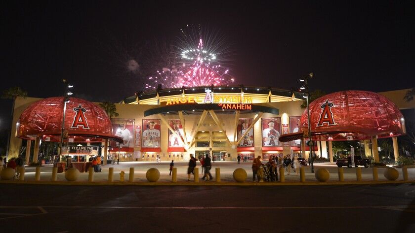 Fireworks light up the night sky behind the entrance to Angel Stadium following a game against the Chicago White Sox in May 2013.