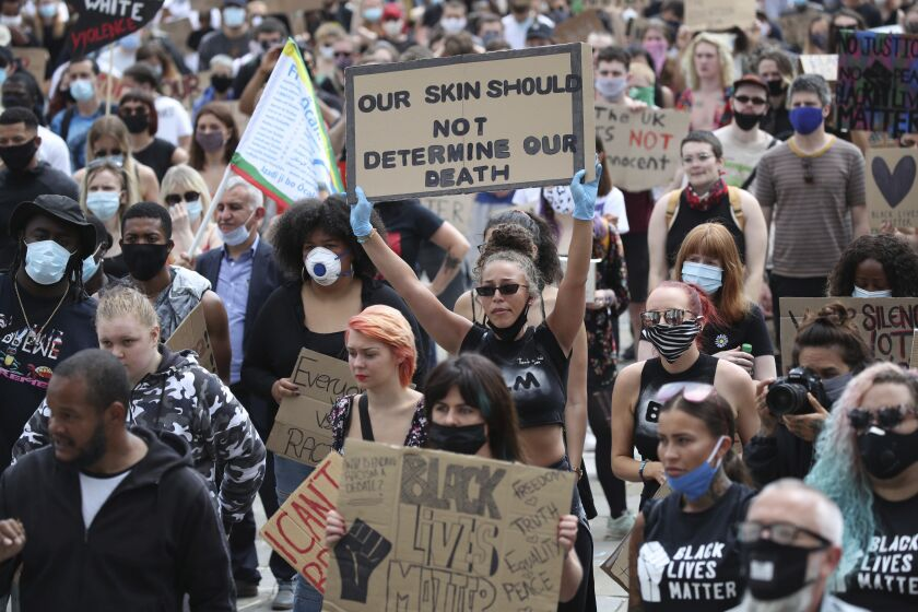 Protesters gather in Leeds, England, Sunday June 14, 2020, during a protest by Black Voices Matter. Global protests are taking place in the wake of George Floyd's death who was killed on May 25 while in police custody in the US city of Minneapolis. (Danny Lawson/PA via AP)