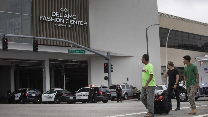 TORRANCE, CA-JUNE 3, 2019: Pedestrians walk past a heavy police presence outside the Del Amo Fashio