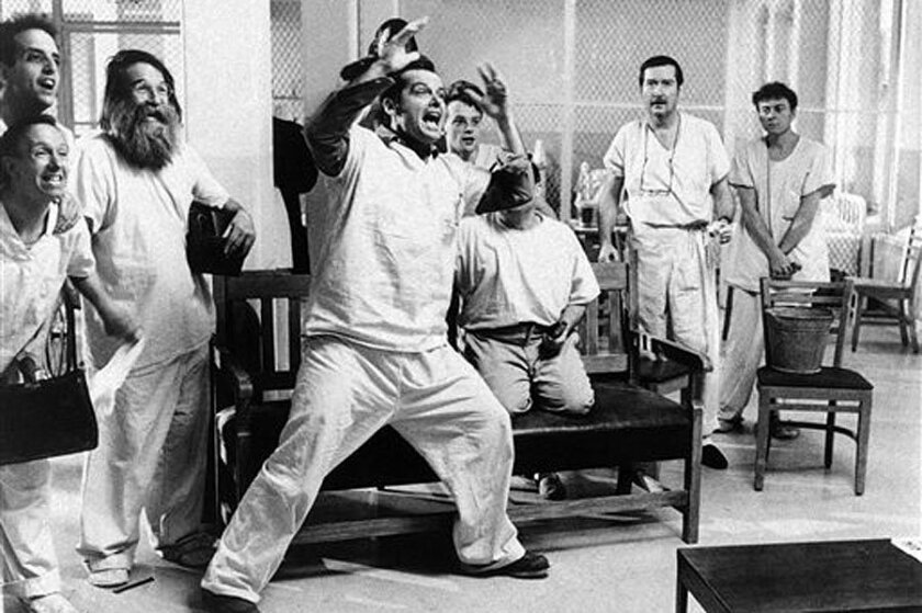 """FILE - In a in Nov. 1975 file photo provided by United Artists, actor Jack Nicholson is shown in a scene from the movie """"One Flew Over The Cuckoo's Nest"""". Louise Fletcher says she's no longer able to watch the movie ìOne Flew Over the Cuckoo's Nestî because the character she won an Oscar for, Nurse Ratched, is so cruel. Fletcher will be in Salem, Ore., on Saturday, Oct. 2012 for the opening of a museum of mental health at the rebuilt Oregon State Hospital, where the 1975 movie was filmed. (AP Photo/United Artists, File)"""