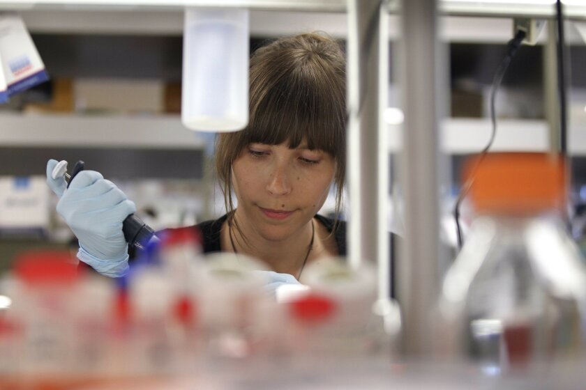 Postdoctoral researcher Nadine Hartmann works with DNA samples at the La Jolla Institute of Allergy and Immunology in La Jolla on July 24. / photo by Hayne Palmour IV * U-T