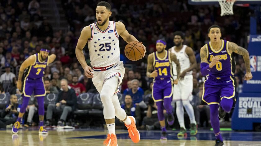 Philadelphia 76ers' Ben Simmons, of Australia, drives up the court during the second half of an NBA