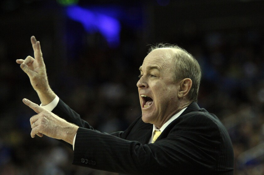 Former UCLA Coach Ben Howland shouts instruction to the Bruins in 2013.