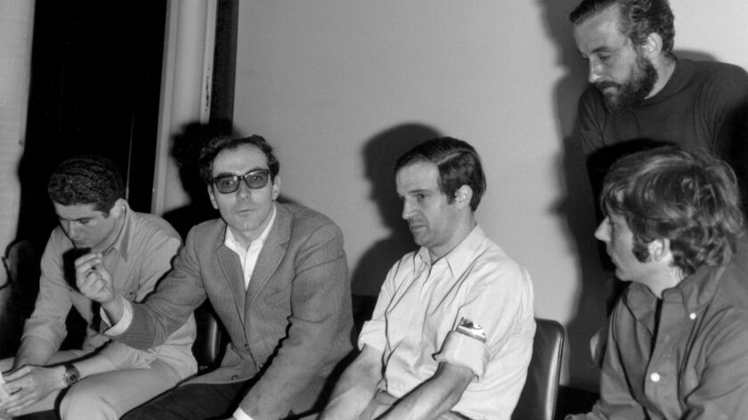 Directors Claude Lelouch, Jean-Luc Godard, François Truffaut, Roman Polanski and Louis Malle (standing) on strike during the Cannes Film Festival to show solidarity with the French students on May 18, 1968.
