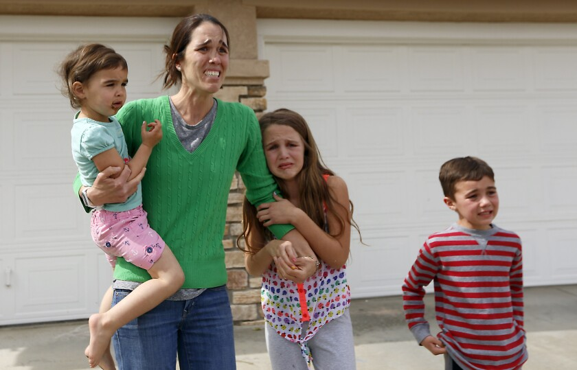 A distraught Summer Page and her children watch as social workers take her 6-year-old foster daughter away.