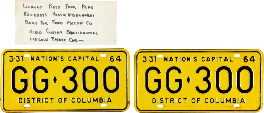 This undated photo provided by Heritage Auction shows the license plates that were on the limousine carrying President John F. Kennedy when he was assassinated in Dallas on Nov. 22, 1963. The plates, which were discarded when the vehicle was sent for upgrades, are going up for auction. (Heritage Au