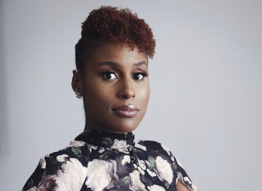"""FILE - Issa Rae poses for a portrait in New York on Aug. 8, 2018. The """"Insecure"""" star is urging people to shop locally as part of Small Business Saturday, a couple days after Thanksgiving. (Photo by Taylor Jewell/Invision/AP, File)"""