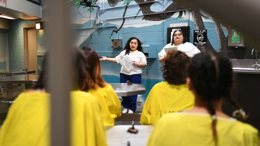 LOS ANGELES, CA-OCTOBER 2, 2017: Karla Espinoza and Josefina Ramirez, standing from left, speak to o