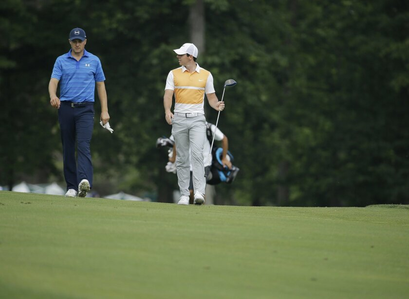 Jordan Spieth talks with Rory McIlroy, of Northern Ireland, as they walk down the 13th fairway during the first round of the Memorial golf tournament, Thursday, June 2, 2016, in Dublin, Ohio. (AP Photo/Darron Cummings)