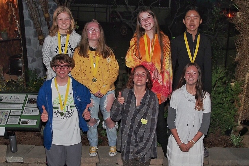 Some of the California Native Plant Club members from San Dieguito High School Academy stand near the award-winning garden they created for the San Diego County Fair. Top row: Paige Estes (left), Grace Mckenzie, Elizabeth Hazard and Kyra Chen. Bottom row: Colton Peacy (left), Hannah Berggren and Mia Laffitte.