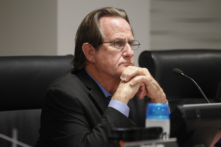 National City Mayor Ron Morrison listens to people speak at a meeting in 2018.