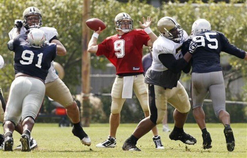 New Orleans Saints quarterback Drew Brees throws downfield against the New England Patriots during a joint football practice in Foxborough, Mass.,  Tuesday, Aug. 10, 2010. (AP Photo/Winslow Townson)
