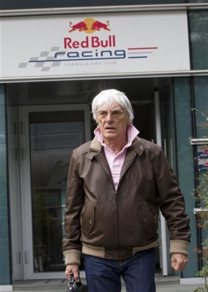 F1 boss Bernie Ecclestone leaves the Red Bull Racing Formula One team office at the Chinese Formula One Grand Prix in Shanghai, China, Thursday, April 12, 2012. (AP Photo/Andy Wong)