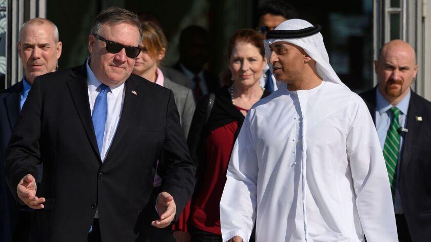 Secretary of State Michael R. Pompeo, left, speaks with Emirati Ambassador to the U.S. Yousef Otaiba in Abu Dhabi on Jan. 13, 2019.
