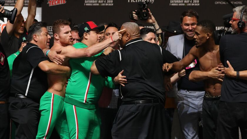 Canelo Alvarez and Daniel Jacobs get into a shoving match during their weigh-in at T-Mobile Arena on Friday in Las Vegas.