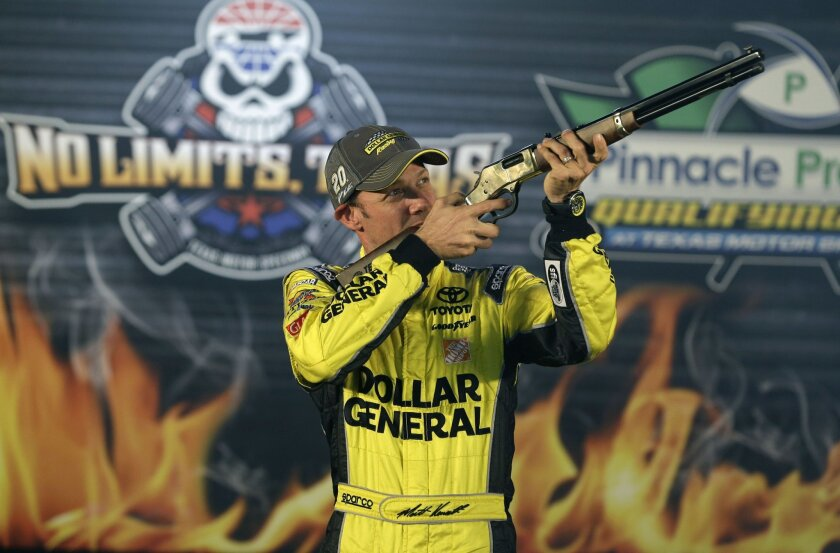 FILE - In this oct. 31, 2014, file photo, Matt Kenseth aims a rifle in Victory Lane after taking the pole position for the NASCAR Sprint Cup Texas 500 auto race, at Texas Motor Speedway in Fort Worth, Texas. It's the wild west in NASCAR right now, and it's not clear if that's good or bad for this c