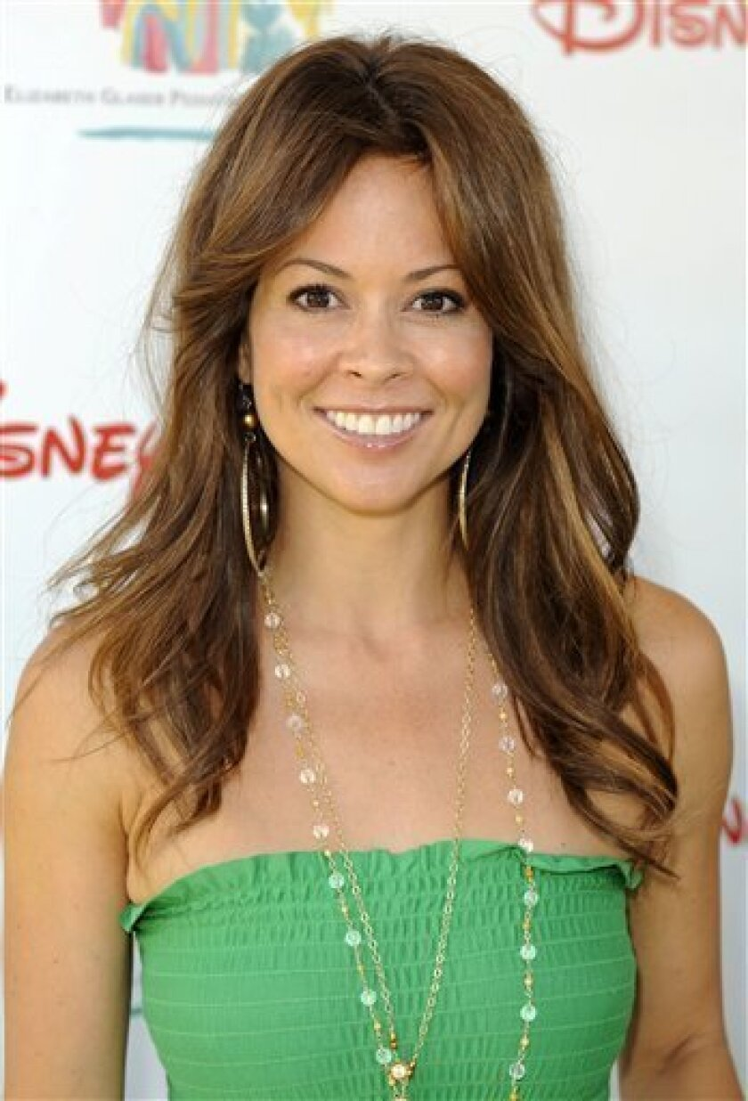 FILE - In this June 7, 2009 file photo, actress Brooke Burke arrives at the 20th anniversary Time for Heroes Celebrity Carnival sponsored by Disney to benefit the Elizabeth Glaser Pediatric Aids Foundation in Los Angeles. (AP Photo/Gus Ruelas, file)