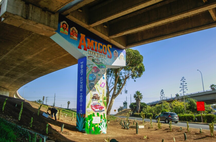 A mural in Chicano Park depicting five cars caravaning north on Interstate 5, from Las Playas de Tijuana to Chicano Park.
