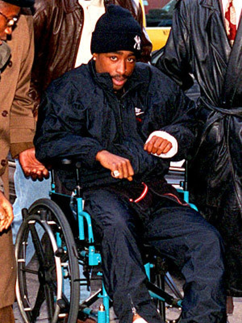 A bandaged Shakur rolls into court in a wheelchair on Dec. 1, 1994, the day after the Quad shooting -- having signed himself out of the hospital against doctors' advice. In court, he was convicted of first-degree sexual abuse in a rape case involving a 19-year-old fan.