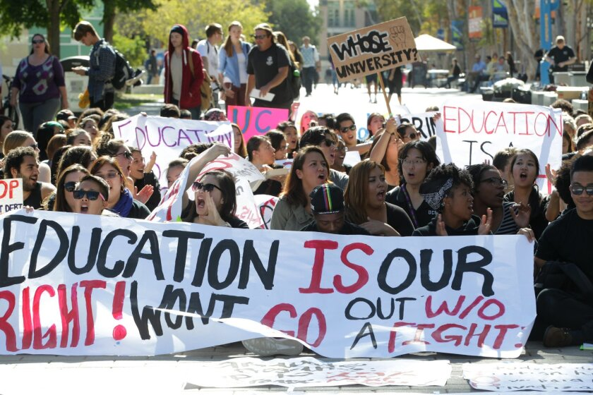 UCSD students protested proposed tuition increases Tuesday outside the Geisel Library.  John Gastaldo/U-T San Diego/Zuma Press