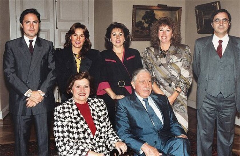 FILE - In this undated file photo former dictator Gen. Augusto Pinochet, seated right, and his wife Lucia Hiriart are accompanied by their children, from left, Marco Antonio, Jacqueline, Veronica, Lucia and Augusto at La Moneda government palace in Santiago, Chile. An investigation into allegations of illegal enrichment by the late Gen. Augusto Pinochet has ended with no charges filed against the dictator's family. Chilean Judge Manuel Antonio Valderrama ended the nine-year probe Monday, Aug. 5,