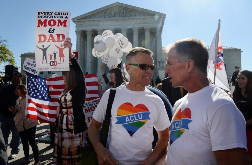 Pro- and anti-gay rights protesters outside the US Supreme Court in April during oral arguments over whether same-sex couples have a constitutional right to marry. A new Gallup poll shows a leftward shift in Americans' attitudes on social issues.