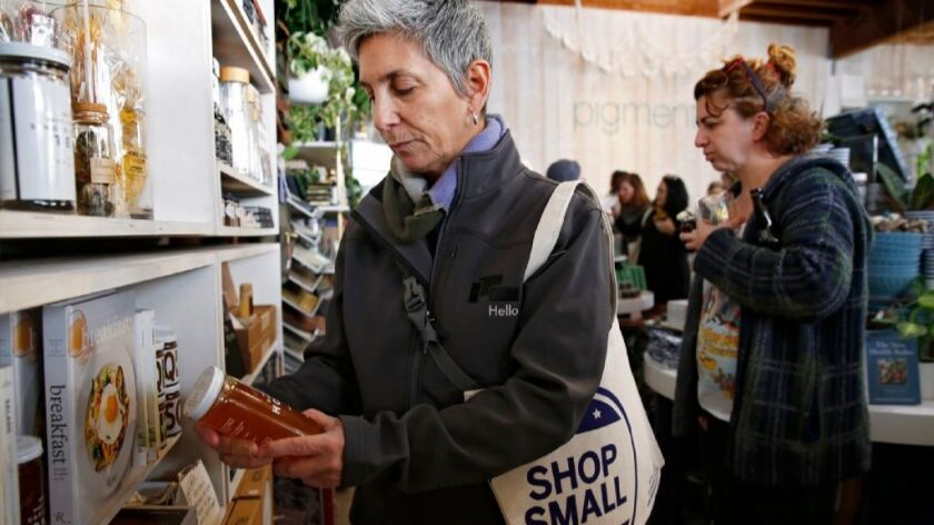 Liz Morrison of Golden Hill looks for holiday gifts at Pigment as she and other shoppers filled boutique stores in North Park in 2016.