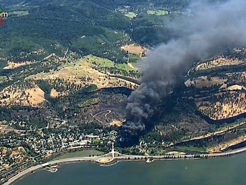 In this frame from video provided by KGW-TV, smoke billows from a Union Pacific train that derailed Friday, June 3, 2016 in Oregon's scenic Columbia River Gorge. The accident sparked a fire and an oil spill near the Columbia River. No injuries were reported. (KGW-TV via AP)