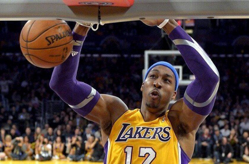 Lakers center Dwight Howard dunks against the Utah Jazz last month.