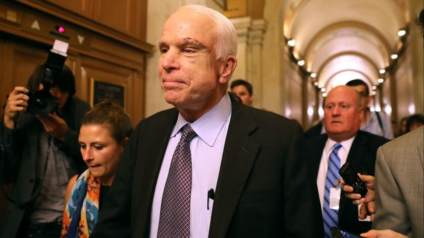 """Sen. John McCain leaves the Senate chamber of the U.S. Capitol after voting 'no' on the GOP """"skinny repeal"""" healthcare bill on July 28, 2017."""