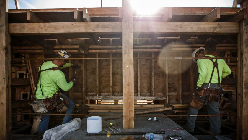 Carpenters in January work on a viaduct being built over Highway 99 in Fresno County as part of the California high-speed rail project.