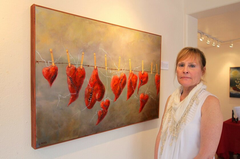 Portrait of artist Colleen Moss with her exhibit at the Cal State University San Marcos Art Galley.