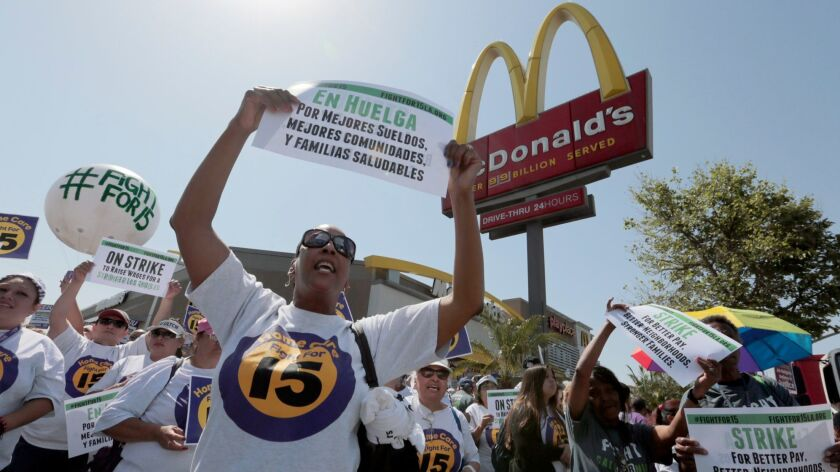 Workers rally outside a McDonald's in L.A. last year to show support for a $15-an-hour minimum wage.