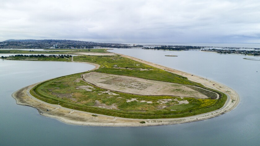 "SAN DIEGO, CA. April 4,- Fiesta Island on San Diego's Mission Bay is the City's ""sandbox."" This drone view looks south at the north end of Fiesta Island, which has a federally protected least tern nesting site, the oblong sandy spot surrounded by the perimeter road. The mostly undeveloped island is the home of Over The Line, Youth aquatic programs, a personal watercraft area, an off-leash dog haven, bicycling, nature preserves, campfires and more. PHOTO/JOHN GIBBINS Staff Photographer San Diego Union-Tribune."
