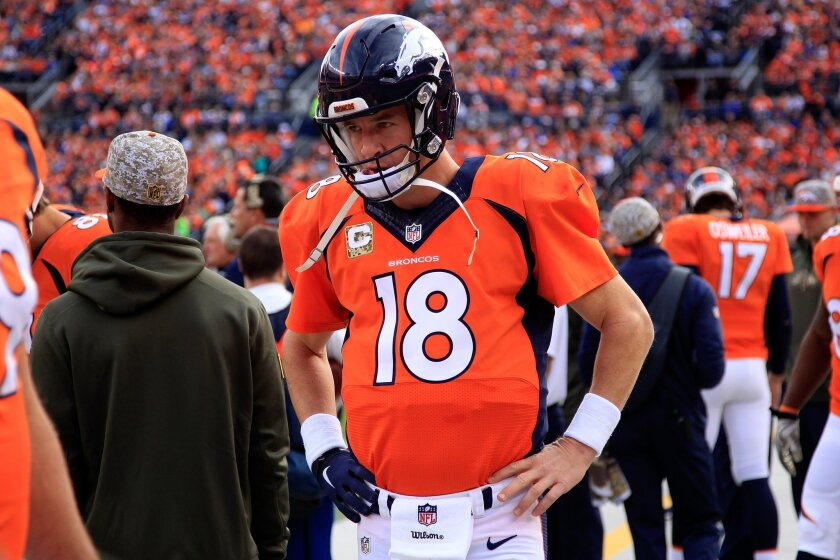 Denver quarterback Peyton Manning prepares to take the field against Kansas City on Sunday.