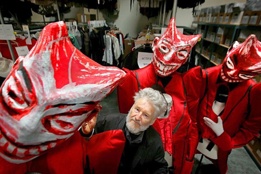 """Achim Freyer, director of the Ring cycle for L.A. Opera, is surrounded by costumes for """"Gotterdammerung,"""" the next opera upcoming in the series at Dorothy Chandler Pavilion."""