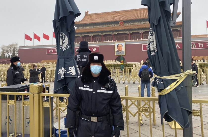 Chinese police officers stand on duty near Tiananmen Gate across from the Great Hall of the People where the annual congress meetings are expected to be held this week in Beijing Tuesday, March 2, 2021. China's legislature begins its annual meeting this week with economic growth and a further crackdown on political opponents in Hong Kong expected to be on the agenda. (AP Photo/Ng Han Guan)