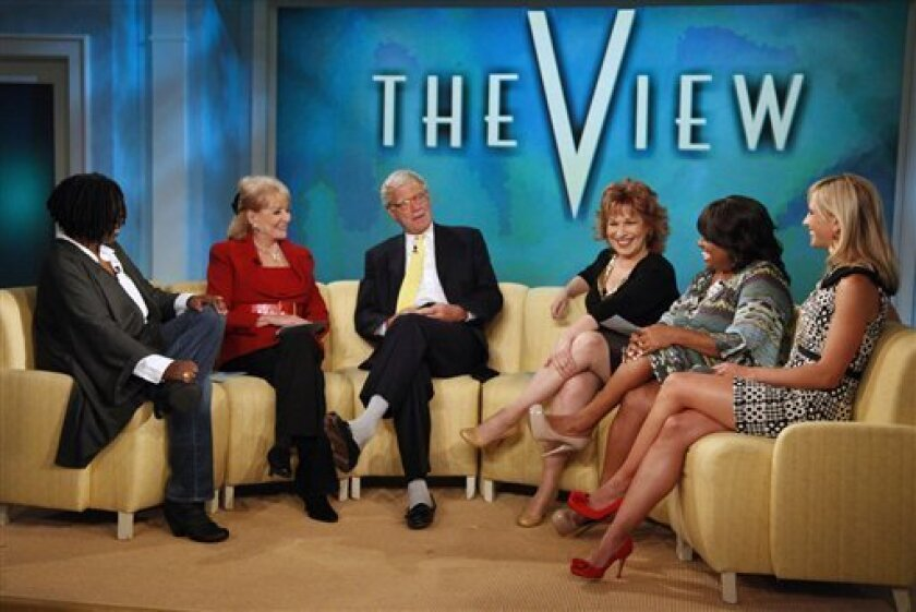 "In this publicity image released by ABC, talk show host David letterman, third left, joins from Left, Whoopi Goldberg, Barbara Walters, Joy Behar, Sherri Shepherd and Elizabeth Hasselbeck, co-hosts of the daytime talk show, ""The View,"" Tuesday, Sept. 7, 2010 in New York. (AP Photo/ABC, Heidi Gutman)"