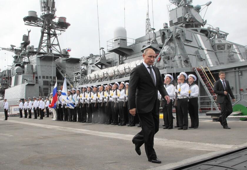 Russian President Vladimir Putin visits the destroyer Vice-Admiral Kulakov at the Black Sea fleet naval base in Novorossiysk, Russia, on Sept. 23, 2014.