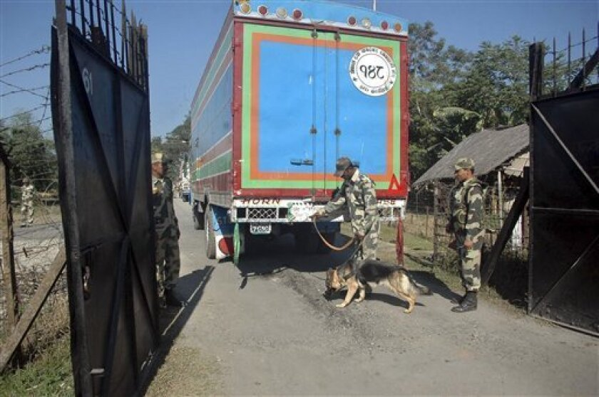 Border Security Force soldiers check a truck entering from Bangladesh at the India-Bangladesh border in Fulbari, about 25 kilometers (16 miles) away from Siliguri, India, Thursday, Dec. 9, 2010. India's security forces routinely gun down cattle smugglers and other civilians crossing the border with
