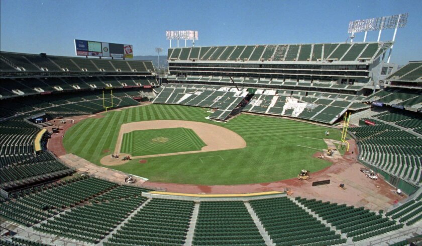 This Aug. 7, 1996, file photo, shows the Oakland Coliseum in transition from baseball to football field configuration in Oakland, Calif. (AP Photo/Ben Margot, File)