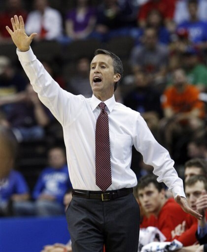 Cornell coach Steve Donahue gestures on the sideline during the first half of an NCAA first-round college basketball game against Temple in Jacksonville, Fla., Friday, March 19, 2010.  (AP Photo/Wilfredo Lee)