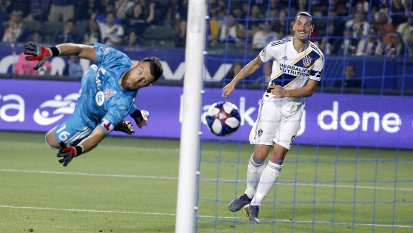 LA Galaxy forward Zlatan Ibrahimovic, right, scores on Toronto FC goalkeeper Quentin Westberg during