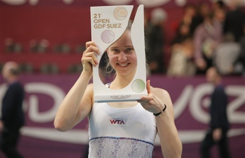 Mona Barthel of Germany holds the trophy following the final match against  Sara Errani of Italy at the 21st Gaz de France WTA Open 2013 tennis tournament at Coubertin stadium, in Paris, Sunday, Feb. 3, 2013. (AP Photo/Francois Mori)