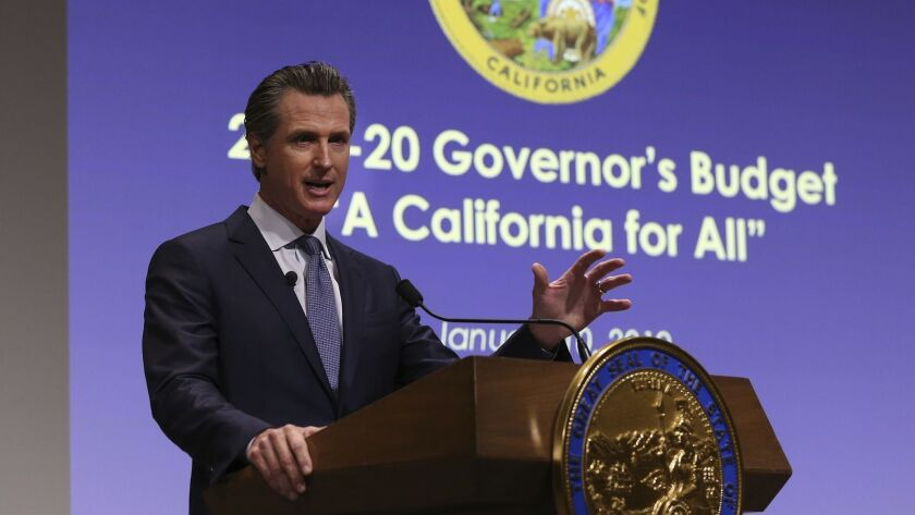 California Gov. Gavin Newsom presents his first state budget, including new spending on healthcare, at a news conference Jan. 10.