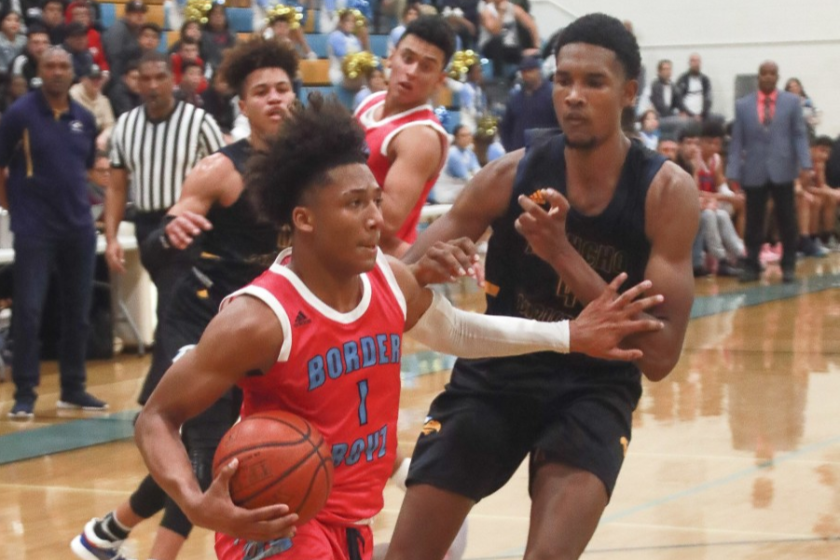 San Ysidro's Mikey Williams tries to elude Rancho Christian's Evan Mobley, the No. 1 player in the nation.