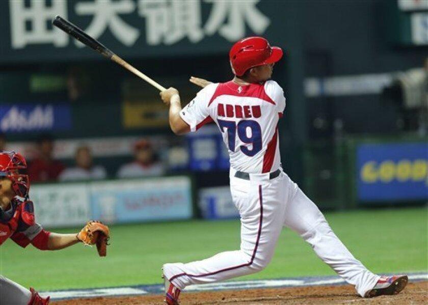 Cuba's first baseman Jose Abreu hits a grand slam off China's Liu Yu in the fifth inning of their World Baseball Classic first round game in Fukuoka, Japan, Monday, March 4, 2013. (AP Photo/Koji Sasahara)