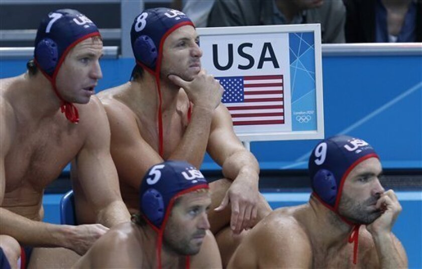 Tony Azevedo, second row top right, of the United States gestures as he sits on the bench with teammates Layne Beaubien, top left, Adam Wright, front left, and Ryan Bailey during their men's water polo preliminary round match against Hungary at the 2012 Summer Olympics, Monday, Aug. 6, 2012, in Lon