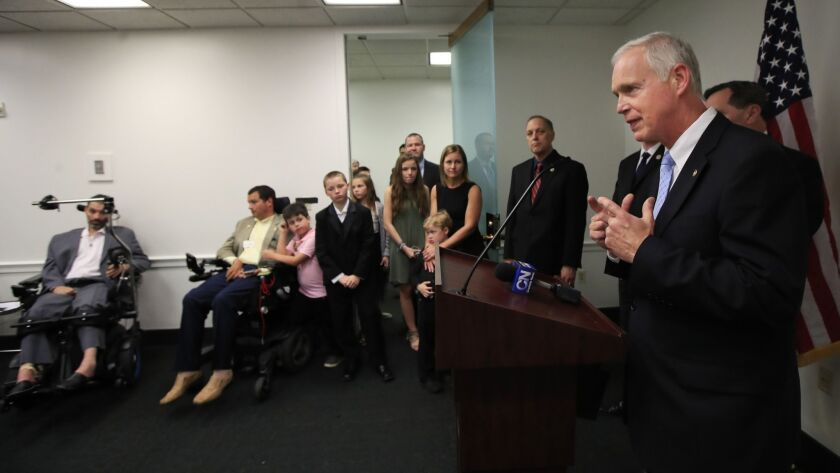 Sen. Ron Johnson, R-Wisc., right, angles for praise for passing a law that will undermine public health.